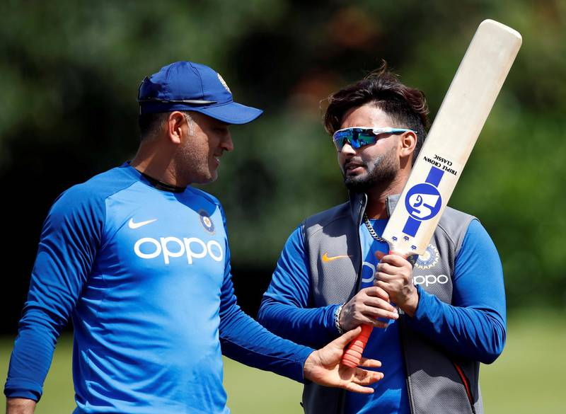 FILE PHOTO: Cricket - ICC Cricket World Cup - India Nets - Edgbaston, Birmingham, Britain - June 29, 2019   India's MS Dhoni (L) and Rishabh Pant during nets   Action Images via Reuters/Andrew Boyers/File Photo