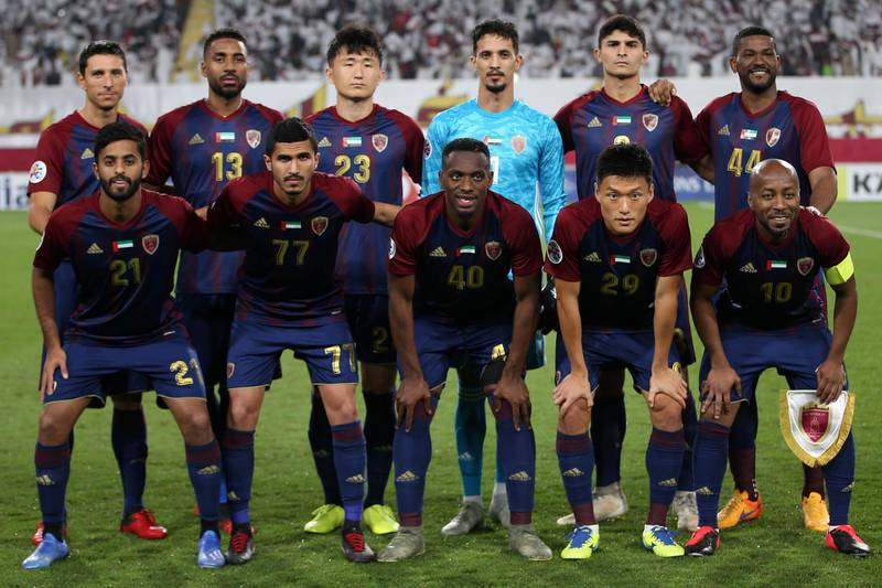 Wahda's starting eleven pose for a group picture ahead of the AFC Champions League group A match between al-Wahda FC and al-Ahli FC at al-Nahyan Stadium in Abu Dhabi on February 10, 2020.  / AFP / -