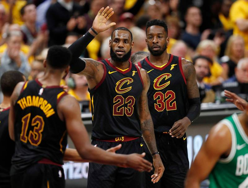 epa06754998 LeBron James (C) of the Cleveland Cavaliers celebrates with Cleveland Cavaliers center Tristan Thompson (L) of Canada as Cavaliers Jeff Green (R) looks on against the Boston Celtics during the second half of game four of the Eastern Conference Finals at Quicken Loans Arena in Cleveland, Ohio, USA, 21 May 2018.  EPA/DAVID MAXWELL  SHUTTERSTOCK OUT