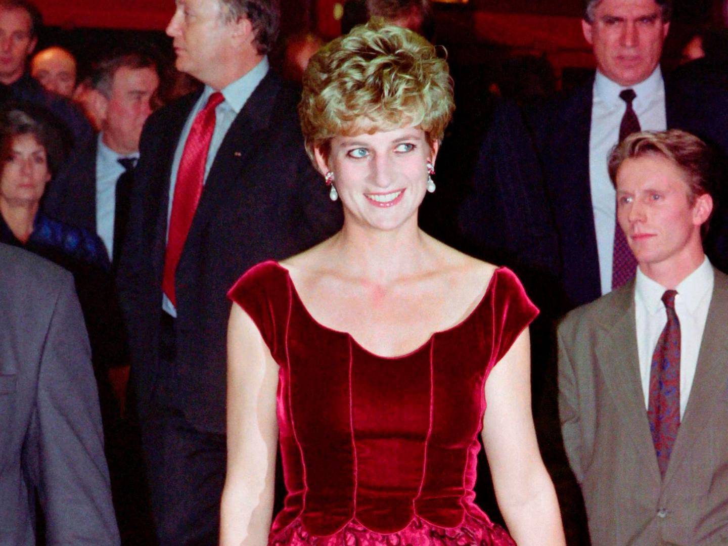 """(FILES) This file photo taken on November 15, 1992 shows Britain's Diana, Princess of Wales, arriving at the Lille Congress Hall in Lille, France, for the opening of Paul McCartney's oratorio """"Liverpool"""". Princess Diana revolutionised the royal dress code with the help of some of the world's greatest designers during a glamorous life that came to a tragic end on August 31, 1997, 20 years ago this month. / AFP PHOTO / AFP PHOTO AND POOL / Jacques DEMARTHON"""