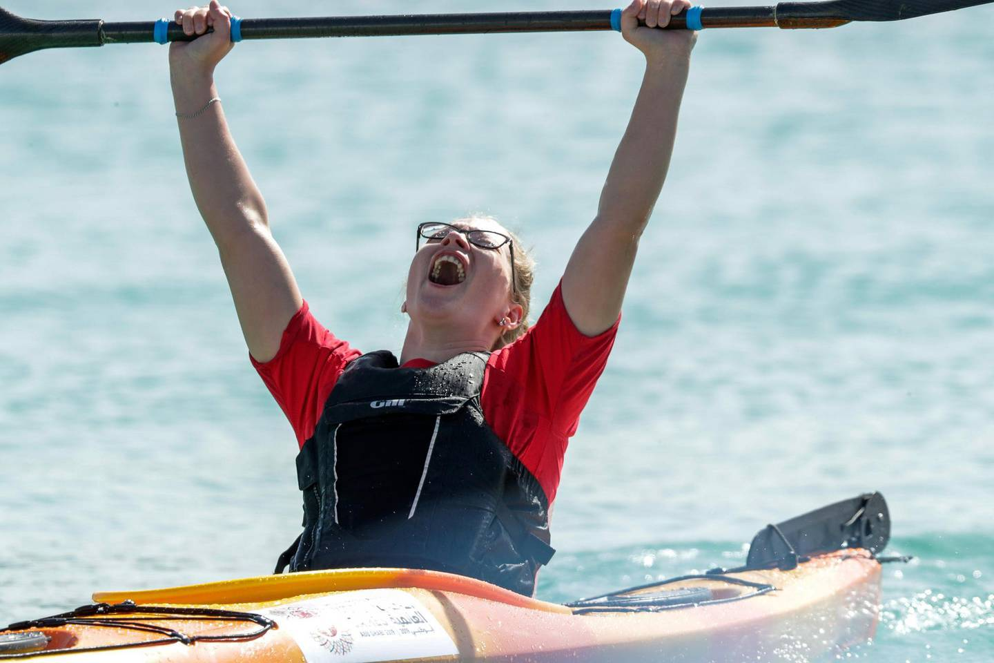 Abu Dhabi, March 18, 2019.  Special Olympics World Games Abu Dhabi 2019. Kayaking at the Marina Yacht club area. -- Irina Egorova takes the win in the first round of Women's Kayaking.Victor Besa/The National