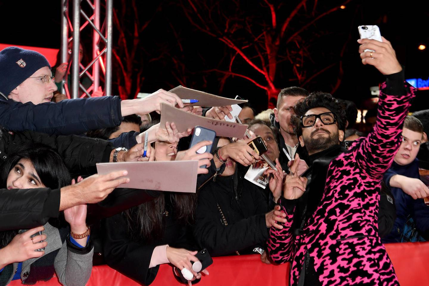 """BERLIN, GERMANY - FEBRUARY 09: Ranveer Singh poses for a selfie with a fan while attending the """"Gully Boy"""" premiere during the 69th Berlinale International Film Festival Berlin at Friedrichstadtpalast on February 09, 2019 in Berlin, Germany. (Photo by Matthias Nareyek/Getty Images)"""