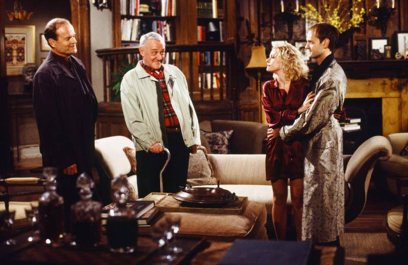 """FRASIER -- """"Shutout in Seattle: Part 1"""" Episode 23 -- Pictured: (l-r) Kelsey Grammer as Dr. Frasier Crane, John Mahoney as Martin Crane. Jessica Cauffiel as Kit, David Hyde Pierce as Dr. Niles Crane  (Photo by Gale M. Adler/NBCU Photo Bank/NBCUniversal via Getty Images via Getty Images)"""