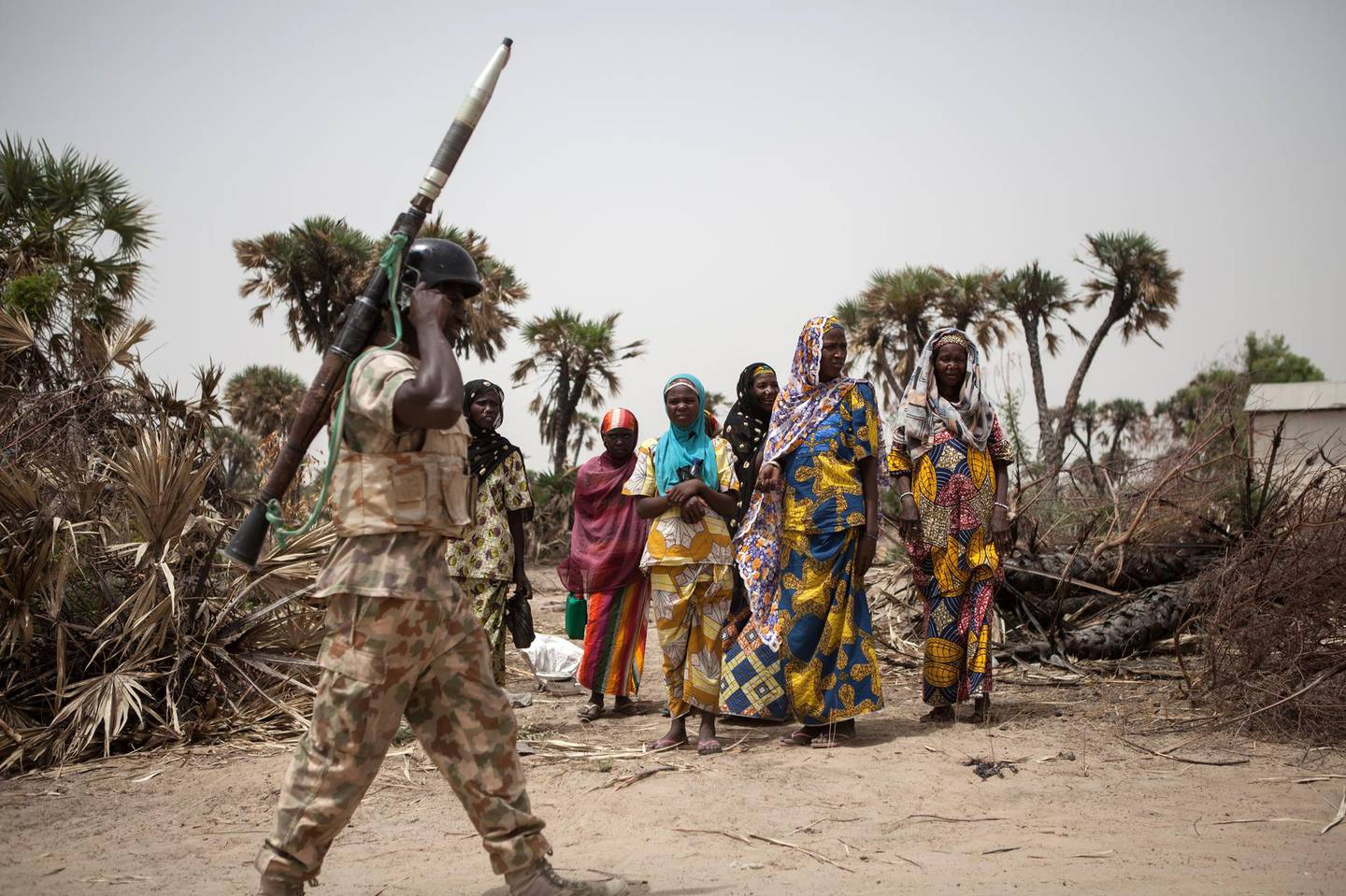 A Nigerian soldier, with a rocket propelled grenade (RPG), patrols on the outskirt of the town of Damasak in North East Nigeria on April, 25 2017 as thousands of Nigerians, who were freed in 2016 by the Nigerian army from Boko Haram insurgents, are returning to their homes in Damasak. - Yagana Bukar's younger brothers Mohammed and Sadiq were among about 300 children kidnapped by Boko Haram from the town of Damasak in remote northeastern Nigeria nearly three years ago. But instead of the global outrage and social media campaign that followed a similar abduction of 219 schoolgirls from the town of Chibok, there were no protests for the children of Damasak. (Photo by Florian PLAUCHEUR / AFP)