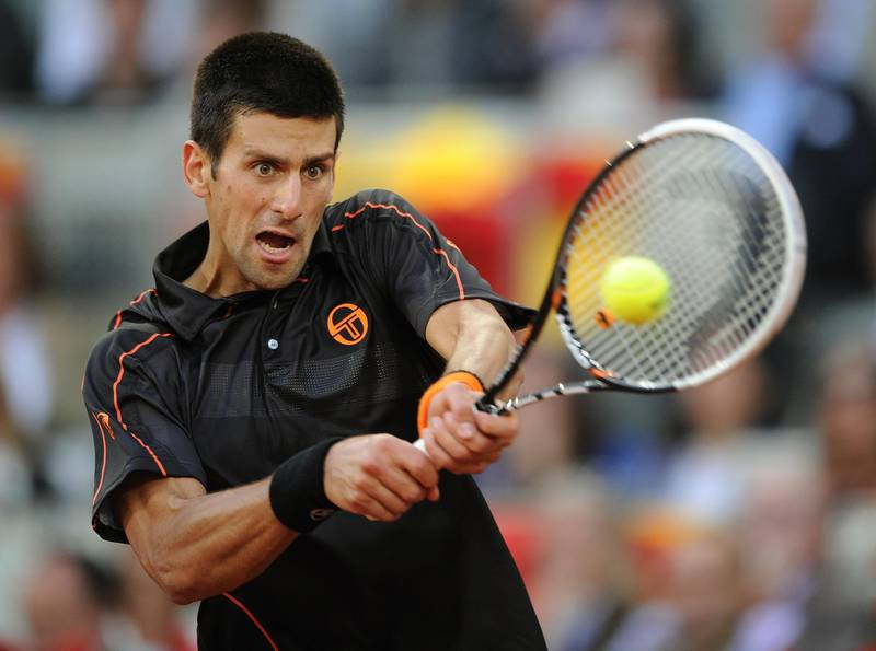MADRID, SPAIN - MAY 08:  Novak Djokovic of Serbia plays a double handed backhand to Rafael Nadal of Spain in his final match during day eight of the Mutua Madrilena Madrid Open Tennis on May 8, 2011 in Madrid, Spain. Djokovic won his match in straight sets.  (Photo by Jasper Juinen/Getty Images)