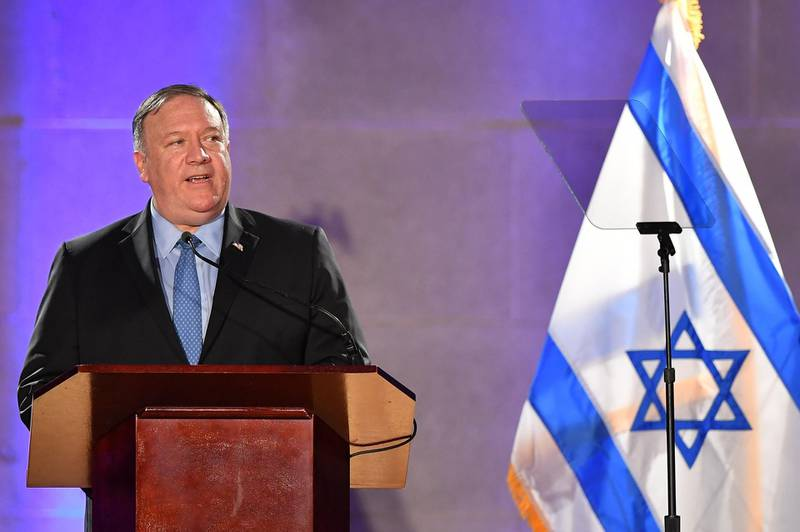 (FILES) In this file photo taken on May 22, 2019, US Secretary of State Mike Pompeo speaks at the Israeli Embassy's Independence Day Celebration in Washington DC.  Pompeo will visit Israel in a show of support for the new coalition government, resuming travel after a coronavirus suspension, the State Department announced on May 8, 2020. The top US diplomat and staunch supporter of Israel will meet Prime Minister Benjamin Netanyahu and his centrist rival turned partner Benny Gantz in Jerusalem on May 13, the day the government is expected to be sworn in. / AFP / Mandel NGAN