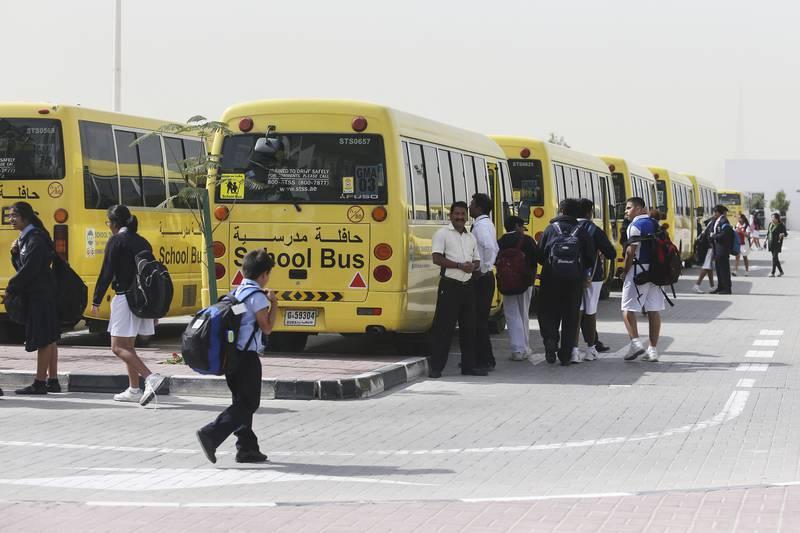 DUBAI, UAE. February 17, 2015 - Stock photograph of students boarding their school buses after school at Gems Modern Academy in Dubai, February 17, 2015. (Photos by: Sarah Dea/The National, Story by: Roberta Pennington, News) *** Local Caption ***  SDEA170215-gemsmodernacademy26.JPG