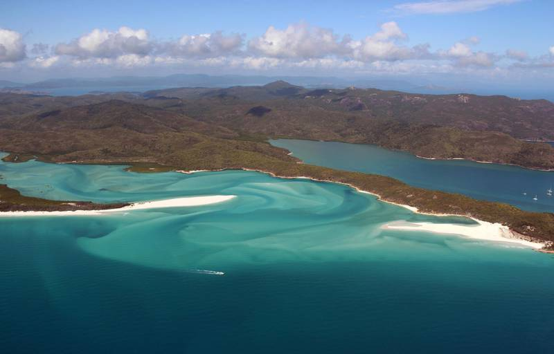 """(FILES) This file photo taken on November 20, 2014, shows an aerial view of the Great Barrier Reef off the coast of the Whitsunday Islands, along the central coast of Queensland. - Climate change has become the biggest threat to UN-listed natural world heritage sites like glaciers and wetlands, and has pushed Australia's Great Barrier Reef into """"critical"""" condition, conservationists said December 2, 2020. (Photo by Sarah LAI / AFP)"""