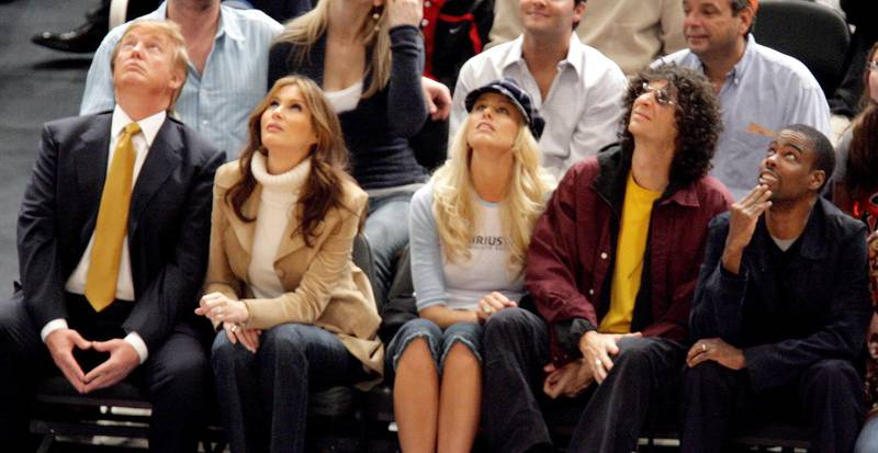 epa00568049 (L-R) Donald Trump, his wife Melania Knauss, model Beth Ostrosky, Howard Stern, and comedian Chirs Rock are seen during the New York Knicks' game against the Washington Wizards at Madison Square Garden Friday 04 November 2005 in New York.  EPA/JUSTIN LANE