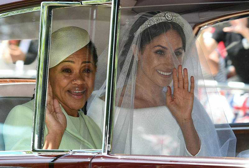 Meghan Markle (R) and her mother, Doria Ragland, arrive for her wedding ceremony to marry Britain's Prince Harry, Duke of Sussex, at St George's Chapel, Windsor Castle, in Windsor, on May 19, 2018. (Photo by Oli SCARFF / AFP)