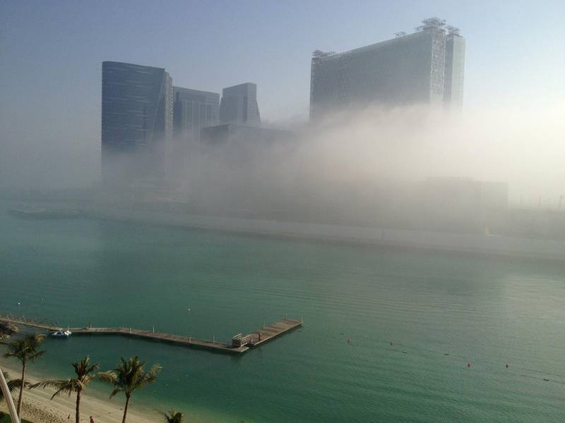 Abu Dhabi, Friday March 15th, 2013. Buildings on Al Maryah Island (Sowwah) wrapped in fog as the sun breaks through at 8:30.   Cool temperatures and dense fog shrouded much of Abu Dhabi island Friday morning. (Brian Kerrigan / The  National)  (Editors note: Al Maryah Island (formerly Sowwah Island)has been classified as an investment zone, setting it at the forefront of Abu Dhabi's real estate opportunities. Itis a 114 hectare mixed-use residential, retail, leisure, hotel and commercial development in the heart of Abu Dhabi. It is designated by the emirate's Urban Planning Council to be the capital's Central Business District (CBD). Sowwah Square is the exclusively commercial first phase of Abu Dhabi's new Central Business District (CBD). (Source: http://www.almaryahisland.ae/)