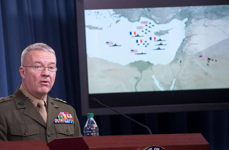 """Director, Joint Staff, US Marine Lt. Gen. Kenneth F. McKenzie Jr., briefs the press on the stikes against Syria, at the Pentagon in Washington, DC, on April 14. 2018.  The Pentagon said Saturday that a joint US-British-French operation against Syria's regime had """"successfully hit every target,"""" countering assertions from Russia that dozens of missiles were intercepted. / AFP PHOTO / SAUL LOEB"""