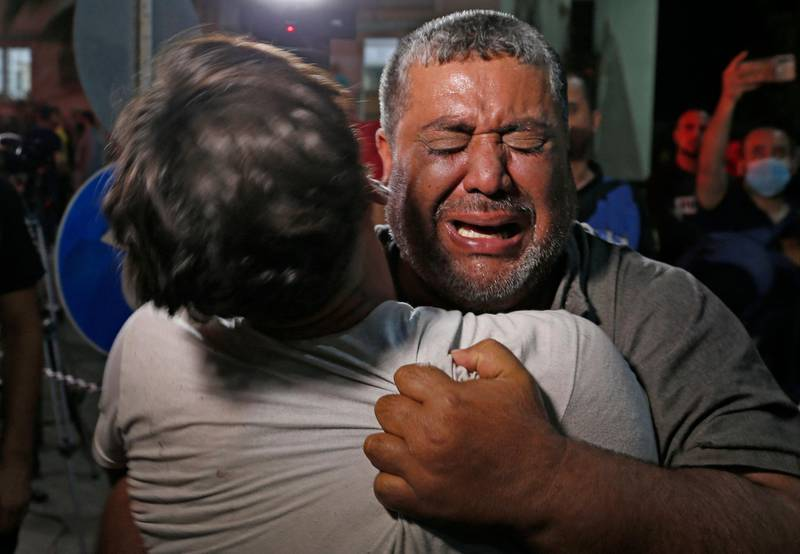 A Palestinian man cries at a hospital in Gaza City City, where those injured or killed in Israeli air strikes are transferred, on, May, 12, 2021. Gaza militants have launched more than 1,000 rockets since the beginning of this week according to Israel's army, which has carried out hundreds of air strikes in the crowded coastal enclave of Gaza. / AFP / Anas BABA