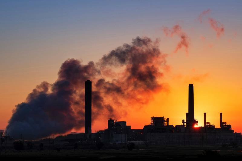 FILE - In this July 27, 2018, file photo, the Dave Johnson coal-fired power plant is silhouetted against the morning sun in Glenrock, Wyo. The Trump administration on Friday targeted an Obama-era regulation credited with helping dramatically reduce toxic mercury pollution from coal-fired power plants, saying the benefits to human health and the environment may not be worth the cost of the regulation. The 2011 Obama administration rule, called the Mercury and Air Toxics Standards, led to what electric utilities say was an $18 billion clean-up of mercury and other toxins from the smokestacks of coal-fired power plants. (AP Photo/J. David Ake, File)