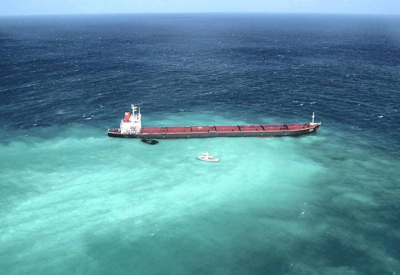 AUSTRALIA - APRIL 4:  Fuel oil leaks from the Shen Neng 1, a Chinese-registered bulk coal carrier grounded in the Great Barrier Reef Marine Park on April 4, 2010, off the coast of central Queensland, Australia. The ship appeared to have veered off its path into a restricted section of the marina park when it ran aground on a shoal on April 3 with approximately 975 tonnes of fuel oil onboard. (Photo by Maritime Safety Queensland via Getty Images)