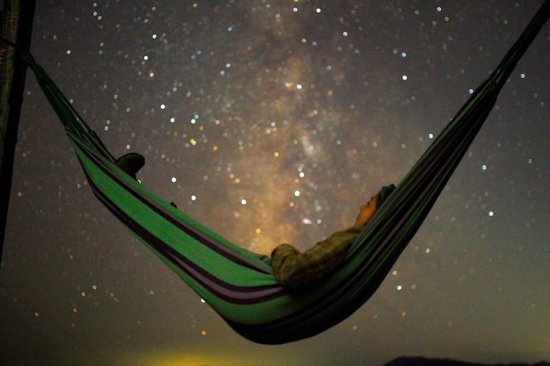 A girl lies in hammock as she looks at the milky way during the peak of Perseid meteor shower in Kozjak, Macedonia August 13, 2018. REUTERS/Ognen Teofilovski
