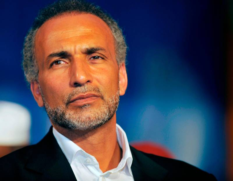"""(FILES) This file photo taken on August 26, 2011 shows Swiss Islamologist Tariq Ramadan giving a speech at the Treichville sports parc, a popular district of Abijdan, during a conference """"Night Destiny (Muslim feast known as Laylat al-Qadr), Night of Peace and Reconciliation"""". Tariq Ramadan is currently under investigation in Paris for alleged """"rape, sexual assault, violence and death threats"""", and is the subject of complaints by two women, including Henda Ayari, who make similar accusations. / AFP PHOTO / SIA KAMBOU"""
