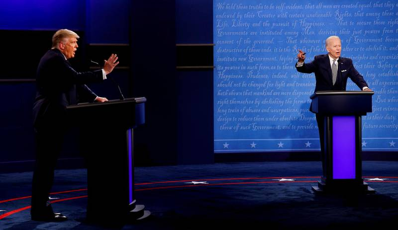 U.S. President Donald Trump and Democratic presidential nominee Joe Biden participate in their first 2020 presidential campaign debate held on the campus of the Cleveland Clinic at Case Western Reserve University in Cleveland, Ohio, U.S., September 29, 2020. REUTERS/Brian Snyder