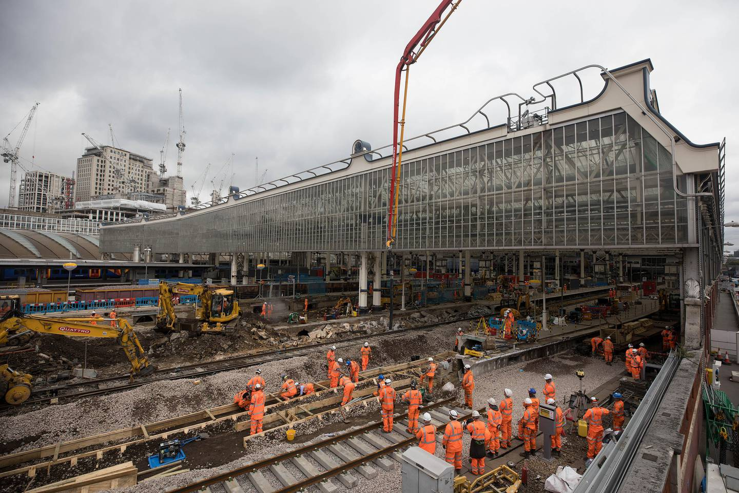Construction workers build new track during renovation works aiming at boosting peak-time capacity 30 percent at London Waterloo train station in London, U.K., on Monday, Aug. 7, 2017. The 800 million-pound ($1 billion) renovation at Waterloo, which will open four platforms mothballed since Channel Tunnel express trains switched to St. Pancras station and extend four more, should deliver a service boost matching the London Bridge project but without the upheaval, Stagecoach Group Plc Chief Executive Officer Martin Griffiths said in July. Photographer: Simon Dawson/Bloomberg
