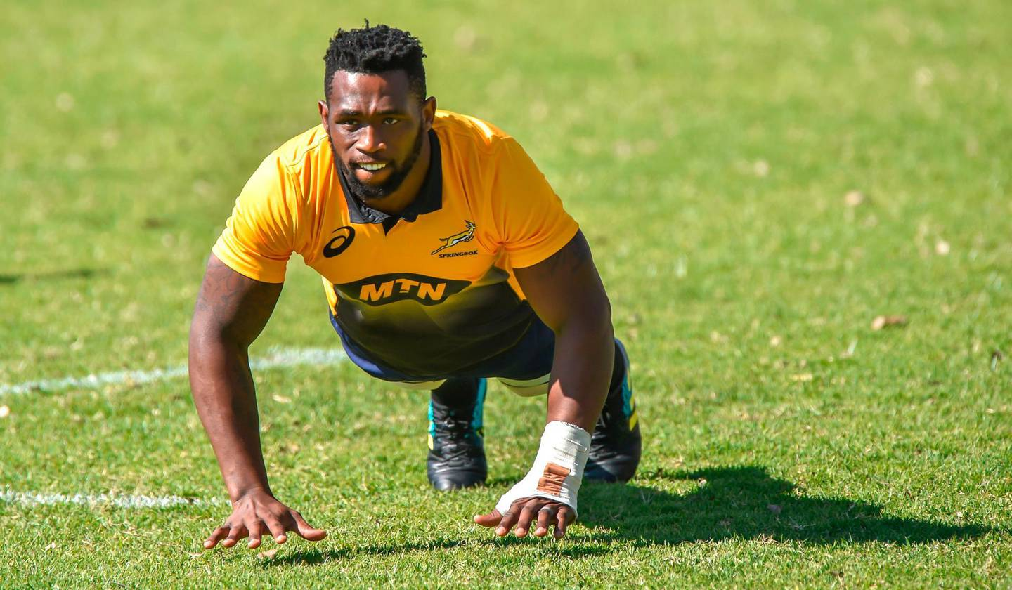 (FILES) In this file photo taken on May 28, 2018, South African flanker Siya Kolisi, the first black Test captain who will lead South Africa in a three-Test series against England in June, attends the first Springboks training session at St Stithies College in Johannesburg.  South Africa's first black Test rugby captain, Siyamthanda 'Siya' Kolisi, had a tough childhood much like the millions of poor black children in the coastal Eastern Cape province. And his astonishing rise to the top will inspire millions of young aspiring players for years to come, rugby analysts say.  - TO GO WITH RUGBYU-RSA-KOLISI,PROFILE BY MICHELLE GUMEDE  / AFP / Christiaan Kotze / TO GO WITH RUGBYU-RSA-KOLISI,PROFILE BY MICHELLE GUMEDE