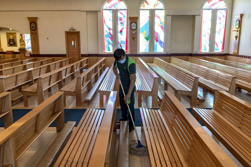 Dubai, United Arab Emirates - Reporter: Kelly Clark: A gentleman cleans at St. Francis of Assisi Catholic Church. Churches suspend mass gatherings and increase cleaning operations. Thursday, March 12th, 2020. Jebel Ali, Dubai. Chris Whiteoak / The National
