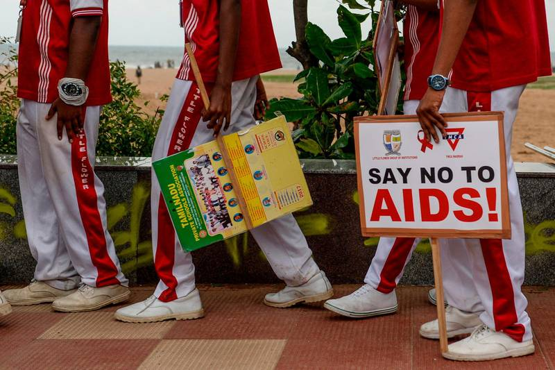 School children hold placards as they participate along with members of LGBT (Lesbians, Gay, Bisexual and Transgender) community in an awareness event on the eve of the 'World AIDS Day' in Chennai on November 30, 2019. / AFP / Arun SANKAR