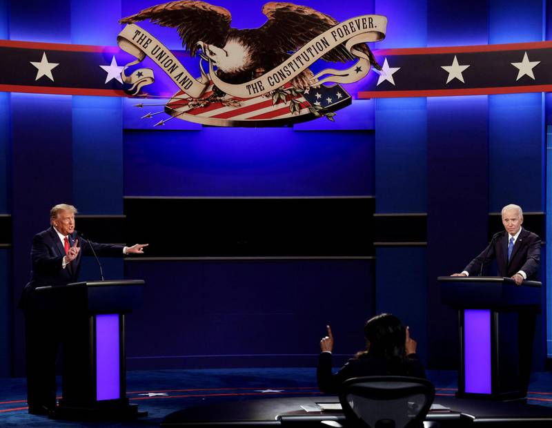 U.S. President Donald Trump and Democratic presidential nominee Joe Biden participate in their final 2020 U.S. presidential campaign debate at Belmont University in Nashville, Tennessee, U.S., October 22, 2020. REUTERS/Mike Segar     TPX IMAGES OF THE DAY