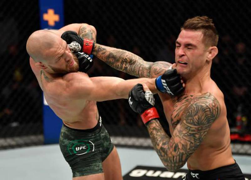 ABU DHABI, UNITED ARAB EMIRATES - JANUARY 23: (L-R) Conor McGregor of Ireland punches Dustin Poirier in a lightweight fight during the UFC 257 event inside Etihad Arena on UFC Fight Island on January 23, 2021 in Abu Dhabi, United Arab Emirates. (Photo by Jeff Bottari/Zuffa LLC)
