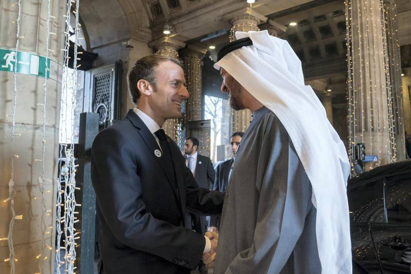 PARIS, FRANCE -November 21, 2018: HH Sheikh Mohamed bin Zayed Al Nahyan, Crown Prince of Abu Dhabi and Deputy Supreme Commander of the UAE Armed Forces (R) is received by HE Emmanuel Macron, President of France (L), commencing a business visit.  ( Mohamed Al Hammadi / Ministry of Presidential Affairs ) ---