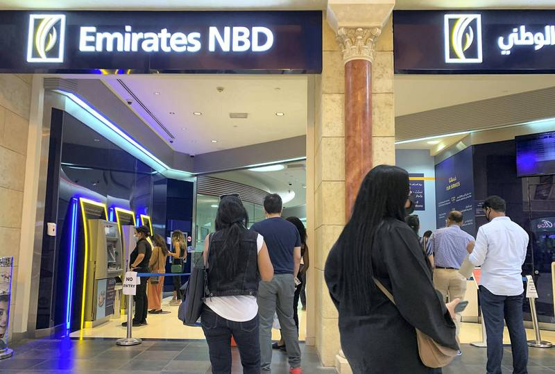 DUBAI, UNITED ARAB EMIRATES , September 13 – 2020 :- People wearing protective face mask as a preventive measure against the spread of coronavirus and waiting for their turn at the Emirates NBD bank at Ibn Battuta Mall in Dubai.  (Pawan Singh / The National) For News/Stock