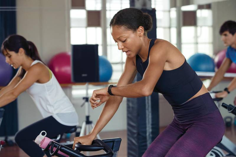 Lifestyle photo of young female at spin class