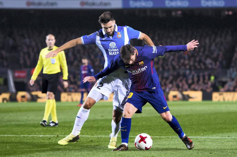 BARCELONA, SPAIN - JANUARY 25: Lionel Messi of FC Barcelona protects the ball from Marc Navarro of RCD Espanyol during the Spanish Copa del Rey Quarter Final Second Leg match between FC Barcelona and RCD Espanyol at Camp Nou stadium at Camp Nou on January 25, 2018 in Barcelona, Spain. (Photo by Alex Caparros/Getty Images)