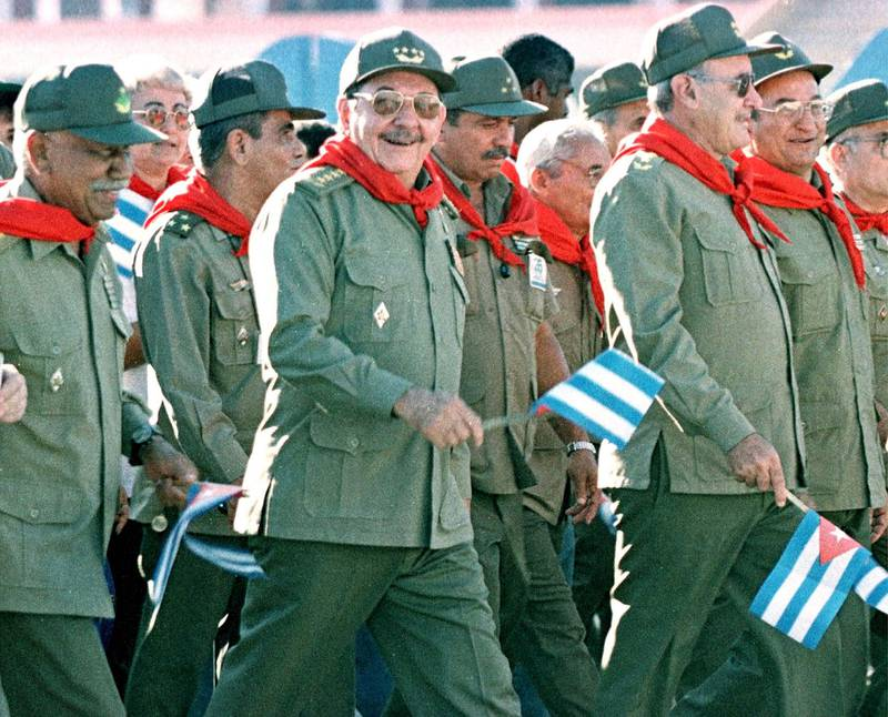 Cuban Armed Forces Minister Raul Castro (C) joins protesters as they march past the U.S. Interests Section in Havana, July 26, 2000. President Fidel Castro led a group of Cubans as they commemorated the date of the Moncada barracks battle of July 26, 1953 in Santiago de Cuba, where Castro-led revolutionaries fought a historic battle against then-dictator Fulgencio Batista. Raul castro is the brother of Fidel.  RP/HB