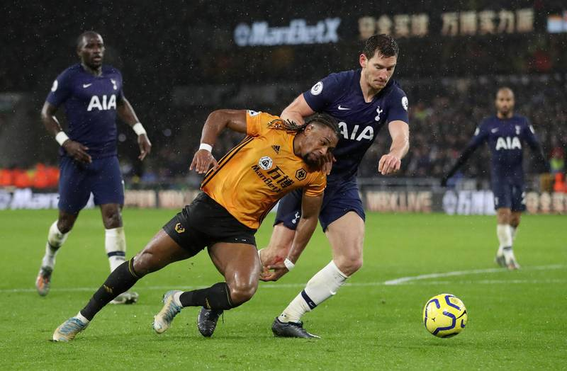 """Soccer Football - Premier League - Wolverhampton Wanderers v Tottenham Hotspur - Molineux Stadium, Wolverhampton, Britain - December 15, 2019  Wolverhampton Wanderers' Adama Traore in action with Tottenham Hotspur's Jan Vertonghen          Action Images via Reuters/Carl Recine  EDITORIAL USE ONLY. No use with unauthorized audio, video, data, fixture lists, club/league logos or """"live"""" services. Online in-match use limited to 75 images, no video emulation. No use in betting, games or single club/league/player publications.  Please contact your account representative for further details."""