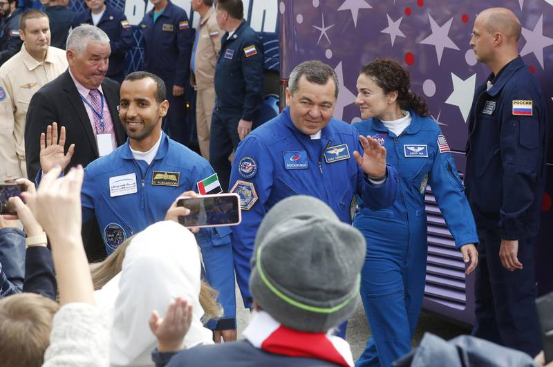 epa07867806 (L-R) Members of the International Space Station (ISS) expedition 61/62, UAE astronaut Hazza Al Mansouri, Roscosmos cosmonaut Oleg Skripochka and NASA astronaut Jessica Meir leave a hotel during the send-off ceremony before the launch of the Soyuz MS-15 spacecraft at the Baikonur cosmodrome in Kazakhstan, 25 September 2019. The launch of the mission of members of the International Space Station (ISS) expedition 61/62 is scheduled on 25 September from the Baikonur Cosmodrome. Mansouri will be the first Emirati in space.  EPA/MAXIM SHIPENKOV
