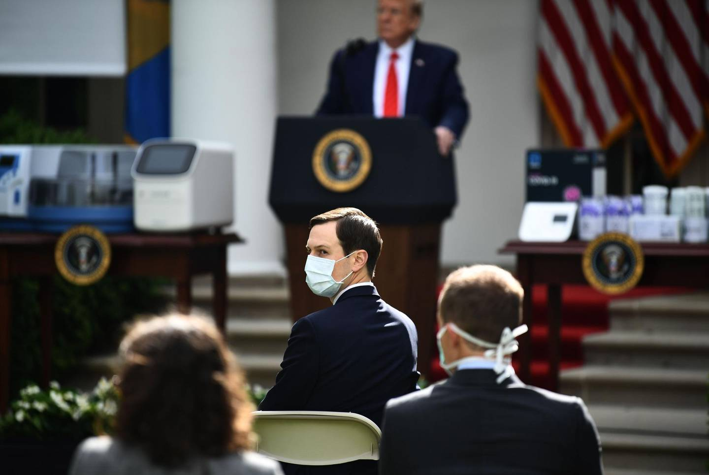 White House Senior Advisor and son-in-law Jared Kushner (C) looks on as US President Donald Trump holds a news conference on the novel coronavirus, COVID-19, in the Rose Garden of the White House in Washington, DC on May 11, 2020. / AFP / Brendan Smialowski