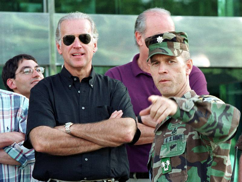 390131 01: US Senate Foreign Relations Committee Chairman Joseph Biden (D-DE), left, and Sen. Fred Thompson (R-TN), center, receive a briefing from Lt. Col. William Miller, UNC Security Battalion Commander, August 11, 2001 at the border village of Panmunjom, South Korea. Four US senators arrived in South Korea August 10 to discuss the issues of North Korea and security concerns with the country''s top leaders. (Photo by Chung Sung-Jun/Getty Images)