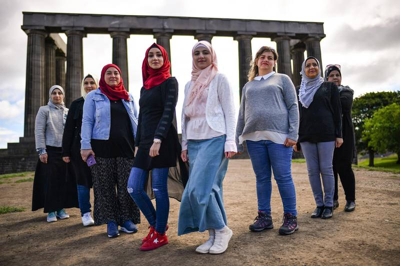 EDINBURGH, SCOTLAND - JULY 01: A group of Syrian refugees hold a photo call on Calton Hill as they look to raise £25,000 to put on their play Euripdes The Trojan Women on July 1, 2019 in Edinburgh, Scotland.  A brand new, haunting and uplifting adaptation of Euripides great anti-war tragedy, written and acted by a cast of Syrian refugees living in Glasgow, performed in Arabic (with subtitles) and English.  (Photo by Jeff J Mitchell/Getty Images)