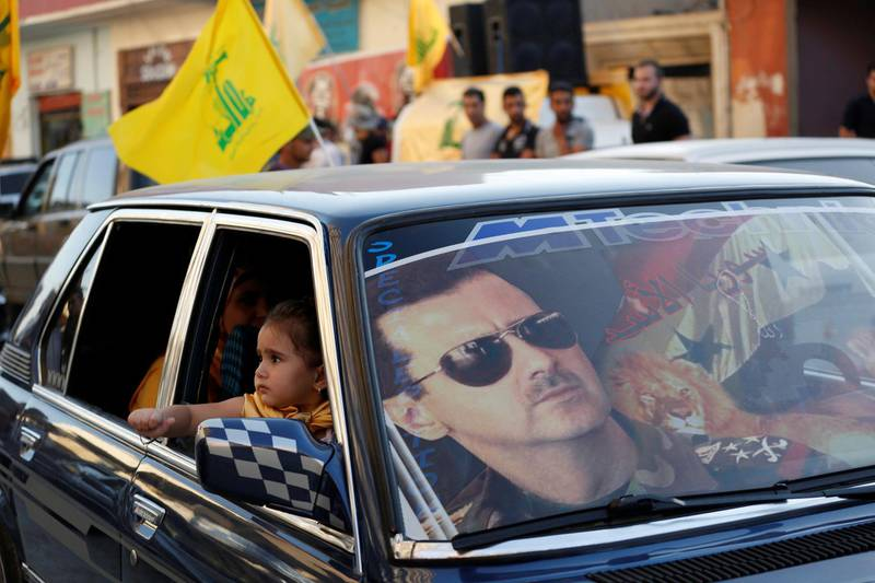 FILE PHOTO: An image of Syria's President Bashar al-Assad is seen on a car's windscreen as Hezbollah supporters celebrate, after the Syrian army took control of Qusair from rebel fighters, in the Shi'ite town of Hermel June 5, 2013. Syrian government forces and their Lebanese Hezbollah allies seized control of the border town of Qusair on Wednesday, dealing a major defeat to rebel fighters battling to overthrow Assad. REUTERS/Jamal Saidi/ File Photo