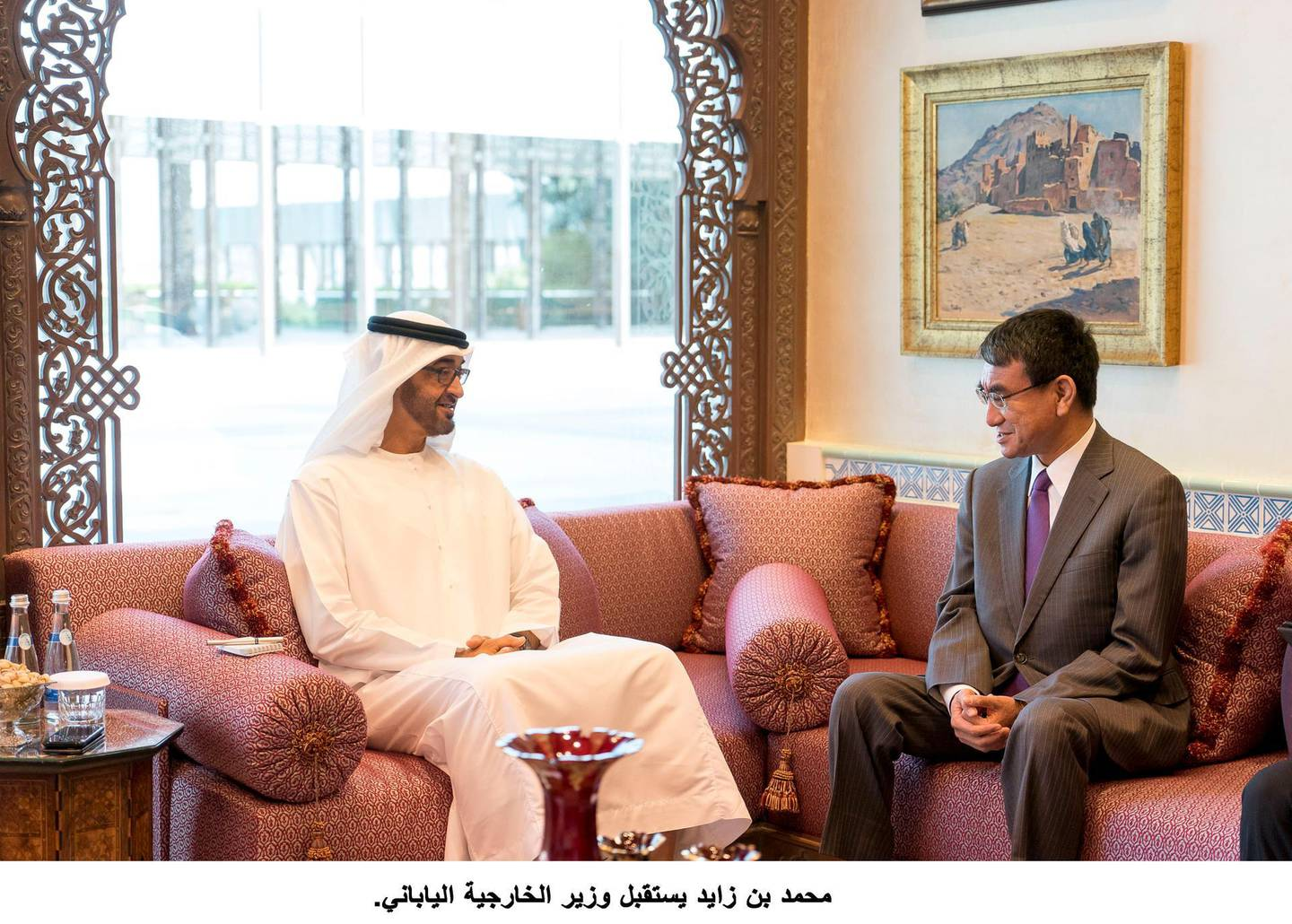 ABU DHABI, UNITED ARAB EMIRATES - December 10, 2017: HH Sheikh Mohamed bin Zayed Al Nahyan Crown Prince of Abu Dhabi Deputy Supreme Commander of the UAE Armed Forces (L), meets with Taro Kono, Minister of Foreign Affairs of Japan (R), at the Sea Palace.( Rashed Al Mansoori / Crown Prince Court - Abu Dhabi )---