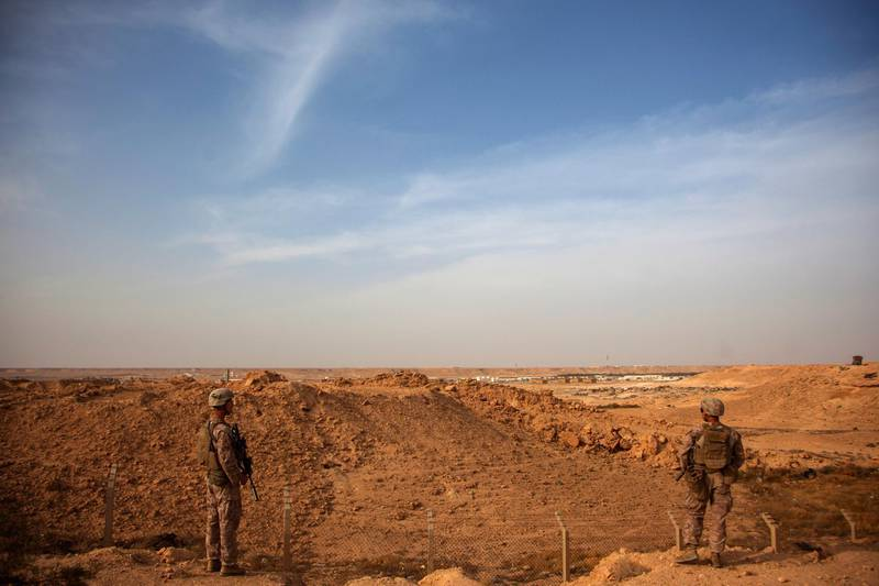 epa08112487 (FILE) - A handout photo made available by the US Marine Corps shows US Marines with Combined Anti-Armor Team, Weapons Company, 1st Battalion, 7th Marine Regiment, patroling inside the perimeter of Al Asad Air Base, Iraq, 23 Oct 2015 (reissued 08 January 2020). According to Iranian state TV on 08 January 2020, Iran's Revolutionary Guard Crops (IRGC) launched a series of rockets targeting al Asad air base, one of the bases hosting US military troops in Iraq. The attack comes days after top Iranian General Qasem Soleimani, head of the IRGC's Quds force, was killed by a US drone strike in Baghdad.  EPA/Cpl. Akeel Austin HANDOUT  HANDOUT EDITORIAL USE ONLY/NO SALES