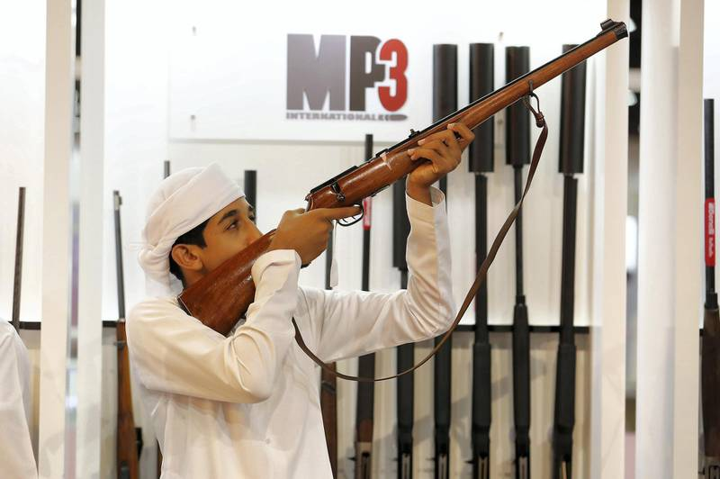 ABU DHABI ,  UNITED ARAB EMIRATES , AUGUST 27 – 2019 :- Visitor looking guns at the MP3 stand during the ADIHEX 2019 held at ADNEC in Abu Dhabi. ( Pawan Singh / The National ) For News/Online/Instagram/Big Picture. Story by Daniel