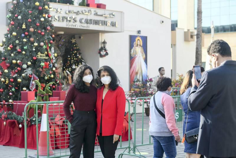 Abu Dhabi, United Arab Emirates - Families take pictures outside St. JosephÕs Cathedral, Mushrif. Khushnum Bhandari for The National