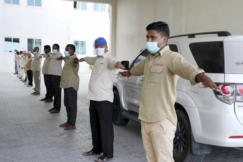 DUBAI, UNITED ARAB EMIRATES , May 01 – 2020 :- Labourers  maintaining safe distance before the distribution of food packets at one of the labour camp in Al Muhaisnah area in Dubai. This is a part of Mohammed Bin Rashid Al Maktoum 10 Million Meals Global Initiative. Volunteers from Beit Al Khair Society will distribute the food packets in the labour camps. Today they are delivering 1000 food packets from Al Nadeg restaurant in Deira Dubai. Total 12000 food packets will be deliver in different labour camps in Dubai. (Pawan Singh / The National) For News/Online/Instagram. Story by Anam