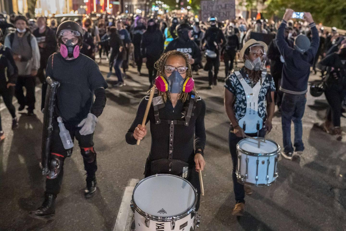 PORTLAND, OR - SEPTEMBER 19: A crowd of anti-police protesters march through downtown on September 19, 2020 in Portland, Oregon. Protests against police brutality and racial injustice resumed this weekend after activists called for a pause in response to hazardous air quality from nearby wildfire smoke.   Nathan Howard/Getty Images/AFP == FOR NEWSPAPERS, INTERNET, TELCOS & TELEVISION USE ONLY ==