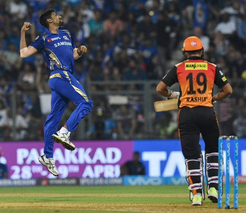 Mumbai Indians cricketer Jasprit Bumrah (L) celebrates after taking the wicket of Sunrisers Hyderabad cricketer Rashid Khan during the 2018 Indian Premier League (IPL) Twenty20 cricket match between Mumbai Indians and Sunrisers Hyderabad at the Wankhede Stadium in Mumbai on April 24, 2018. / AFP PHOTO / INDRANIL MUKHERJEE / ----IMAGE RESTRICTED TO EDITORIAL USE - STRICTLY NO COMMERCIAL USE----- / GETTYOUT
