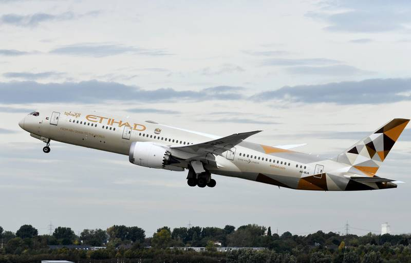 This picture shows a Boeing 787-10 Dreamliner of the Etihad airline during take-off on September 24, 2019 at the airport in Duesseldorf, western Germany. (Photo by INA FASSBENDER / AFP)