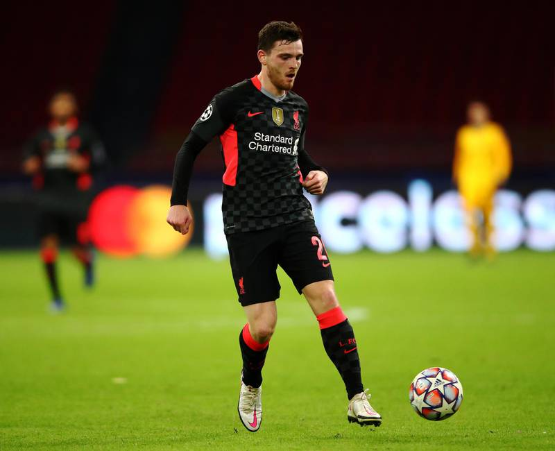 AMSTERDAM, NETHERLANDS - OCTOBER 21: Andrew Robertson of Liverpool in action during the UEFA Champions League Group D stage match between Ajax Amsterdam and Liverpool FC at Johan Cruijff Arena on October 21, 2020 in Amsterdam, Netherlands. (Photo by Dean Mouhtaropoulos/Getty Images)