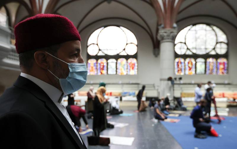 Muslims pray inside the evangelical church of St. Martha's parish, during their Friday prayers, as the community mosque can't fit everybody in due to social distancing rules, amid the coronavirus disease (COVID-19) outbreak in Berlin, Germany, May 22, 2020.   REUTERS/Fabrizio Bensch