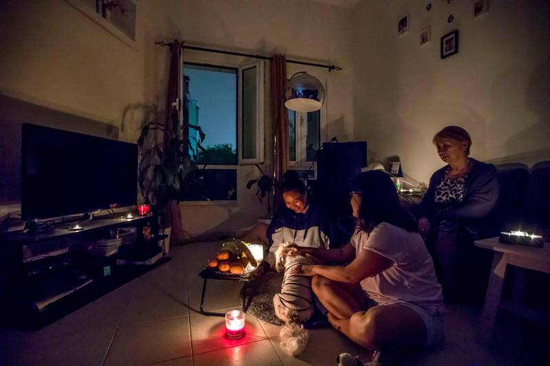 Dubai, United Arab Emirates- A family playing with their pet during Earth Hour.  Ruel Pableo for The National